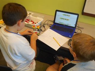 Siblings Learn To Program Their Lego® WeDo Robot.