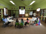 Kids participating in a class at Illiana's STEM learning center