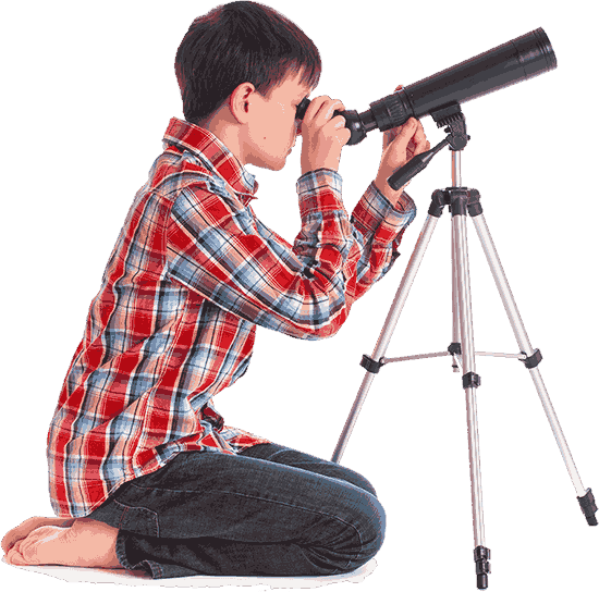 Child looks through telescope